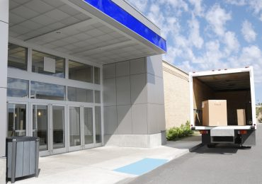 Moving truck at building door